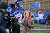 Deutsche Welle (DW) news presenter on College Green, outside the Houses of Parliament, on the day MPs voted decisively to reject Theresa May's withdrawal deal with the EU.  Westminster, London.