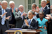Washington, D.C. - June 22, 2009 -- United States President Barack Obama joins the applause after signing the Family Smoking Prevention and Tobacco Control Act in the Rose Garden of the White House on Monday, June 22, 2009. From left to right: U.S. Representative John Dingell (Democrat of Michigan), U.S. Senator Chris Dodd (Democrat of Connecticut), U.S. Representative Henry Waxman (Democrat of California), President Obama, and representatives from the Campaign for Tobacco Free Kids.Credit: Ron Sachs - Pool via CNP