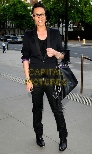 GOK WAN.HarperCollins Publisher Summer Party, Victoria & Albert Museum, London, England..July 1st, 2008.V&A V & A Harper Collins full length black jacket trousers bag sunglasses shades tattoos .CAP/CAN.©Can Nguyen/Capital Pictures.