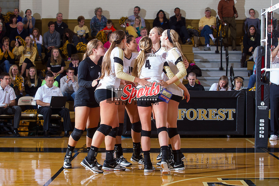 The Wake Forest Demon Deacons huddle up during the match against the Miami Hurricanes in Reynolds Gymnasium on October 25, 2013 in Winston-Salem, North Carolina.  The Demon Deacons defeated the Hurricanes 3-1.   (Brian Westerholt/Sports On Film)