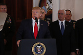 United States President Donald J. Trump delivers an address to the nation concerning the missile attack by Iran on US forces in Iraq from the Grand Foyer of the White House in Washington, DC on Wednesday, January 8, 2020.<br />