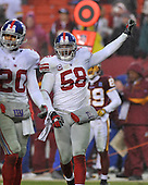 Landover, MD - November 30, 2008 -- New York Giants linebacker Antonio Pierce (58) calls defensive signals in fourth quarter action against the Washington Redskins at FedEx Field in Landover, Maryland on Sunday, November 30, 2008.  The Giants won the game 23 - 7..Credit: Ron Sachs / CNP.(RESTRICTION: No New York Metro or other Newspapers within a 75 mile radius of New York City)