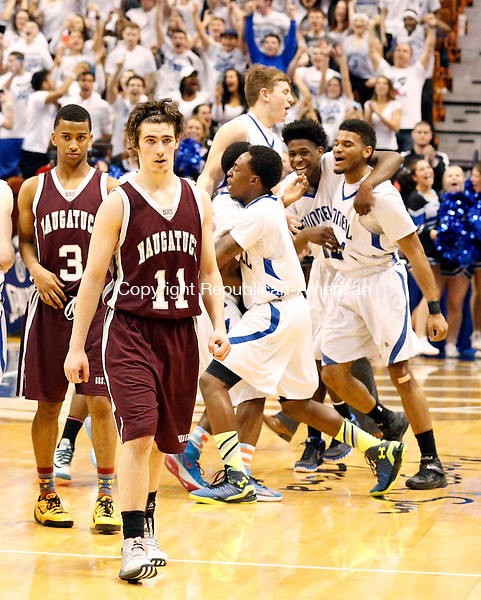 Uncasville, CT- 22 March 2015-032215CM13- Naugatuck's Charles Wall (3) and Jason Bradley begin to walk off court as Bunnell starts their celebration during the  Class L state championship game at Mohegan Sun Arena in Uncasville on Sunday.    Christopher Massa Republican-American