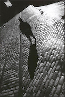 Man standing on cobblestone street