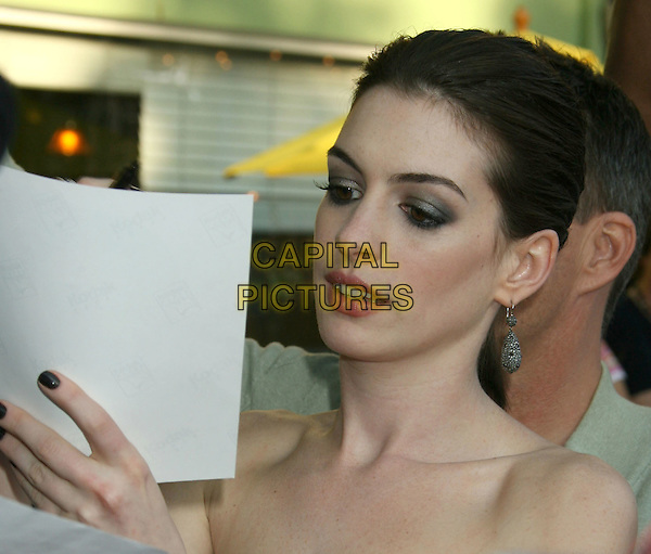 "ANNE HATHAWAY.""Get Smart"" Los Angeles Premiere held at Mann's Village Theatre, Westwood, California, USA..June 16th, 2008.headshot portrait strapless dangling earrings silver grey gray.CAP/ADM/MJ.©Michael Jade/AdMedia/Capital Pictures."