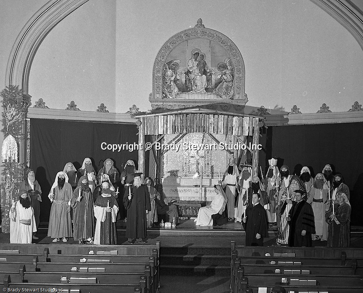 Pittsburgh PA: View of the Christmas play; the birth of baby Jesus, at the First Luthern Church on Grant Street in Pittsburgh - 1958.  Members of the congregation doned period clothing the recreate Christmas night 1958 years earlier.  The cast posing for a photo before services.