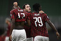 Davide Calabria of AC Milan celebrates with Rafael Leao and Franck Kessie after scoring a goal during the Serie A football match between AC Milan and Bologna FC at stadio Giuseppe Meazza in Milano ( Italy ), July 18th, 2020. Play resumes behind closed doors following the outbreak of the coronavirus disease. <br /> Photo Image Sport / Insidefoto