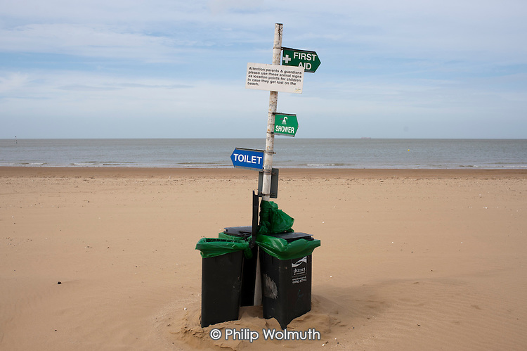 Refuse bins and signage on the beach in Margate, Kent.