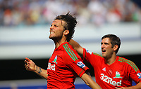 FAO SPORTS PICTURE DESK<br /> Pictured: Michu of Swansea celebrating his opening goal. Saturday 18 August 2012<br /> Re: Barclay's Premier League, Queens Park Rangers v Swansea City FC at Loftus Road Stadium, London, UK.