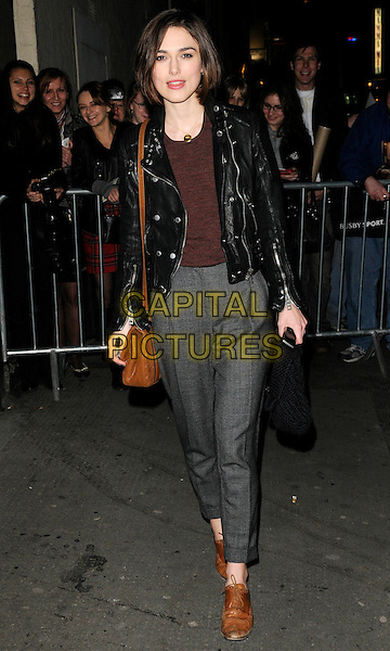 "KEIRA KNIGHTLEY.Departing from the evening performance of ""The Children's Hour"", Comedy Theatre, London, England, UK, .March 22nd 2011..full length grey gray trousers black leather jacket  brown shoes bag brogues .CAP/CAN.©Can Nguyen/Capital Pictures."