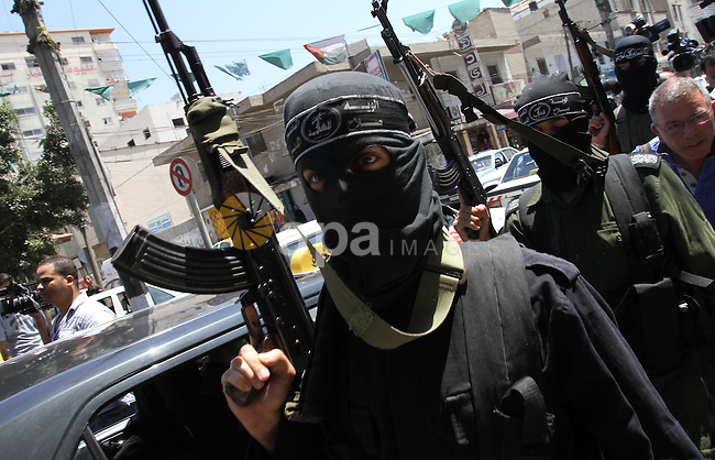 "Palestinian militants of the Nasser Salah al-Din Brigades the military wing of the Popular Resistance Committees take part in a press conference, in Gaza city on Aug. 22, 2011 to announce a temporary halt of rocket fire at Israel. One official who was involved in mediating talks between Israel and Palestinian factions in Gaza said the groups had ""reached an understanding on a truce and that the truce has started"". Photo by Mohammed Asad"