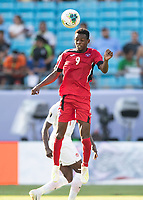CHARLOTTE, NC - JUNE 23: Maykel Reyes #9 heads the ball during a game between Cuba and Canada at Bank of America Stadium on June 23, 2019 in Charlotte, North Carolina.
