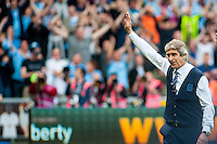 Manuel Pellegrini, Manager of Manchester City waves at the away supporters during the Barclays Premier League match between Swansea City and Manchester City played at the Liberty Stadium, Swansea on the 15th of May  2016