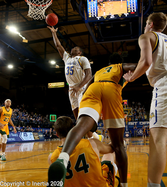BROOKINGS, SD - JANUARY 22: Douglas Wilson #35 of the South Dakota State Jackrabbits lays the ball up against the North Dakota State Bison at Frost Arena on January 22, 2020 in Brookings, South Dakota. (Photo by Dave Eggen/Inertia)