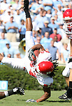 02 September 2006: Rutgers' Willie Foster is flipped upside down while running back the opening kickoff. The University of North Carolina Tarheels lost 21-16 to the Rutgers Scarlett Knights at Kenan Stadium in Chapel Hill, North Carolina in an NCAA Division I College Football game.