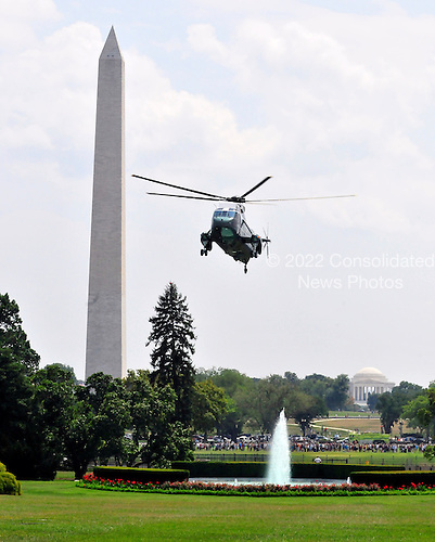Marine One, carrying United States President Barack Obama and his family returns to the South Lawn of the White House in Washington, D.C. from a weekend at Camp David, the presidential retreat near Thurmont, Maryland..Credit: Ron Sachs / Pool via CNP