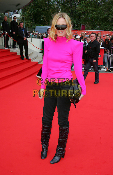ROISIN MURPHY.Red carpet arrivals at the Vodafone Live Music Awards at Earls Court, London, England. .September 19th, 2007.full length pink top sunglasses shades visor black jeans denim tucked into black boots bag purse .CAP/ROS.©Steve Ross/Capital Pictures