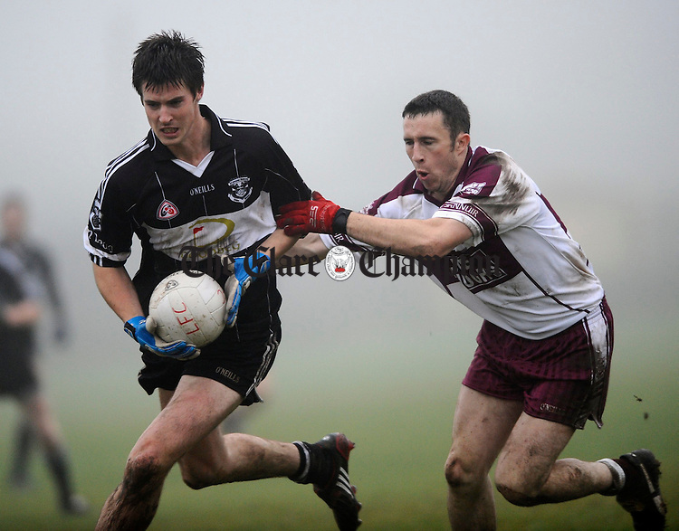 Doonbeg's Colm Dillon is tackled by Liscannor's Davy Mc Donagh during their semi final at Miltown Malbay. Photograph