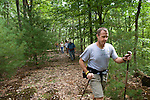 Dave hiking trail with poles.