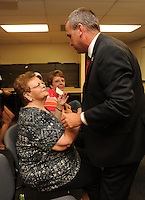 NWA Democrat-Gazette/ANDY SHUPE<br /> Capt. Matt Mills of the University of Arkansas Police Department, speaks Wednesday, Sept. 2, 2015, with Myrrah Mueller of Farmington and her daughter, Paula Mueller of Prairie Grove, during a ceremony to award the Muellers with the American Police Hall of Fame Medal of Honor at the University of Arkansas Police Department in Fayetteville. Myrrah Mueller's husband, West Fork Police Chief Paul Mueller, was shot and killed on March 20, 1981, while making a traffic stop in West Fork following a robbery in Fayetteville.