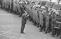 A lone member of the Apprentice Boys of Derry appeals, unsuccessfully, to the line of riot police for his fellow members to be allowed to march along the lower section of the Ormeau Road, Belfast, N Ireland, en route to Londonderry for the annual parade of that organisation held traditionally on the last Saturday of August i.e 31st August 1996. This stretch of road has been a flashpoint since the sectarian murder by the UFF of five Roman Catholics in a betting shop in 1992. 199608310591<br />