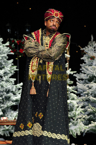 DON GILET.First Family Entertainment theatre company's annual group Pantomime photocall at Piccadilly Theatre, London, England..November 26th, 2010.stage costume panto pantomime full length black gold red cape jacket trousers turban sash arms crossed 3/4.CAP/CAS.©Bob Cass/Capital Pictures.