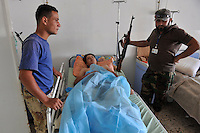 17 year old Muhammed Bisha lies in Tripoli Central Hospital. He was shot by a sniper. After a six month revolution, rebel forces finally managed to break into Tripoli and have taken control of Bab al-Aziziyah, Col Gaddafi's compound and residence. Few remain that are loyal to Gaddafi in the city; it is seeming that the 42 year regime has come to an end. Gaddafi is currently on the run. Over the recent days 50 rebel fighters have died in this hospital.