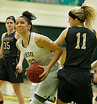 SPEARFISH, SD - FEBRUARY 4, 2017 -- Sierra Toms #23 of Black Hills State drives around Tori Fisher #11 of UCCS during their Rocky Mountain Athletic Conference game Saturday at the Donald E. Young Center in Spearfish, S.D.  (Photo by Dick Carlson/Inertia)