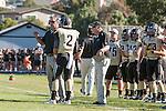 Palos Verdes, CA 09/27/13 - Michael Christensen (Peninsula Head Coach) and Larry Olson (Peninsula Coach) in action during the Lawndale vs Palos Verdes Peninsula Varsity football game at Peninsula High School.