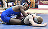Jacori Teemer of Long Beach, left, battles Joe Barcellos of North Shore at 132 pounds during the Nassau County Divsision I varsity wrestling quarterfinals at Hofstra University on Saturday, Feb. 11, 2017. Teemer won the match by fall at 3:08.