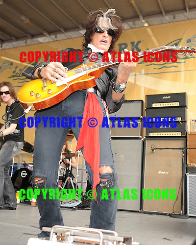 MIAMI  FL - DECEMBER 06: Joe Perry performs on the Land Shark stage during the pregame show at Land Shark stadium on December 6, 2009 in Miami Beach, Florida.(Photo By Larry Marano (C) 2009