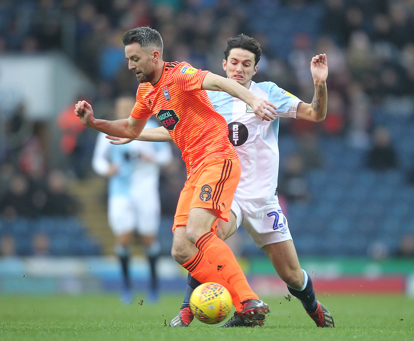 Blackburn Rovers Lewis Travis in action with Ipswich Town's Cole Skuse<br /> <br /> Photographer Mick Walker/CameraSport<br /> <br /> The EFL Sky Bet Championship - Blackburn Rovers v Ipswich Town - Saturday 19 January 2019 - Ewood Park - Blackburn<br /> <br /> World Copyright © 2019 CameraSport. All rights reserved. 43 Linden Ave. Countesthorpe. Leicester. England. LE8 5PG - Tel: +44 (0) 116 277 4147 - admin@camerasport.com - www.camerasport.com