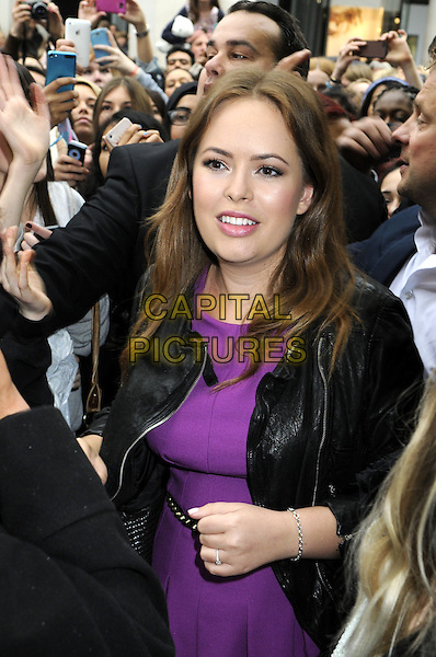 Beauty blogger Tanya Burr is swamped by fans at her meet and greet in Covent Garden, London, England.<br /> May 29th 2013<br /> half length purple dress black leather jacket <br /> CAP/PP/BK<br /> &copy;Bob Kent/PP/Capital Pictures