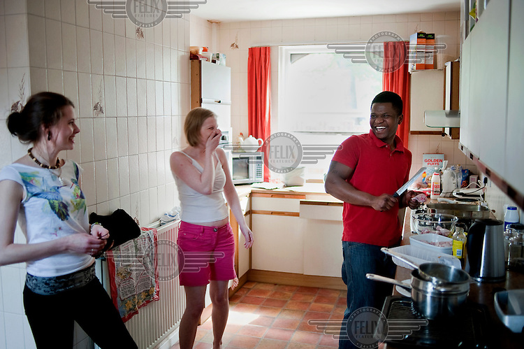 Antonio Bravo prepares for a barbeque with his housemates at their home in Leeds. Antonio's father Manuel committed suicide so the family wouldn't have to be deported back to Angola.