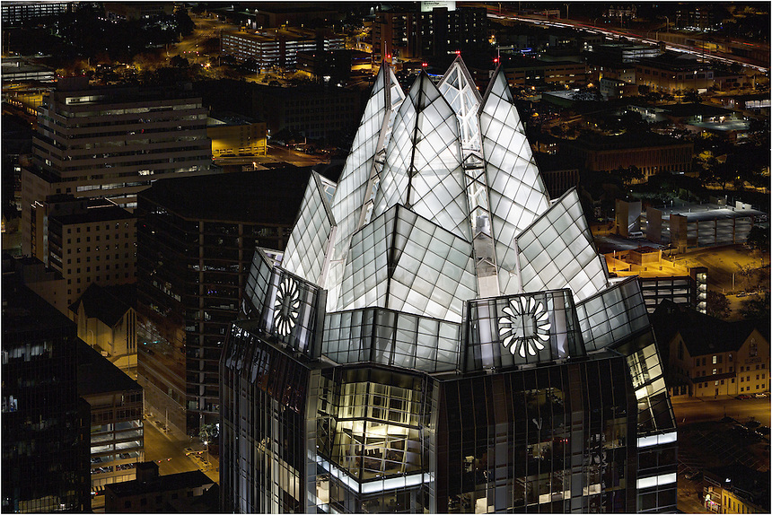 From atop the Austonian, the sleek Frost Tower is lit up below in downtown Austin, Texas.