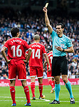 Referee Juan Martinez Munuera (r) shows Jesus Navas Gonzalez of Sevilla FC the yellow card during the La Liga 2017-18 match between Real Madrid and Sevilla FC at Santiago Bernabeu Stadium on 09 December 2017 in Madrid, Spain. Photo by Diego Souto / Power Sport Images