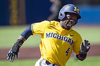 Michigan Wolverines second baseman Ako Thomas (4) rounds third base against the Illinois Fighting Illini during the NCAA baseball game on April 8, 2017 at Ray Fisher Stadium in Ann Arbor, Michigan. Michigan defeated Illinois 7-0. (Andrew Woolley/Four Seam Images)