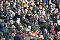 West Ham fans fight each other during West Ham United vs Burnley, Premier League Football at The London Stadium on 10th March 2018