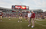 Florida State head coach Bobby Bowden (R) and offensive coordinator and head-coach-in-waiting Jimbo Fisher talk prior to the first half of the University of Miami Hurricane's 38-34 defeat of the Florida State Seminoles in Tallahassee September 7, 2009. (Mark Wallheiser/TallahasseeStock.com)