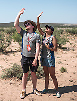Spectators track a rocket at the Spaceport America Cup near the town of Truth or Consequences, New Mexico, June 24, 2017. The International Intercollegiate Rocket Engineering Competition hosted over 110 teams from colleges and universities in eleven countries. Students launched solid, liquid, and hybrid rockets to target altitudes of 10,000 and 30,000 feet. The 2017 Spaceport America Cup winner was the University of Michigan, Ann Arbor, Team 79.<br /> <br /> Photo by Matt Nager