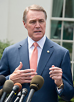 United States Senator David Perdue (Republican of Georgia) speaks to reporters outside the White House after meeting US President Donald J. Trump to discuss his proposed legislation to enact a skills-based immigration system called the Reforming American Immigration for a Strong Economy (RAISE) Act that they claim would also result in a lower level of immigration. Photo Credit: Ron Sachs/CNP/AdMedia
