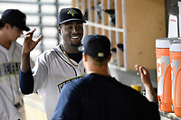 Tony Dibrell (8) of the Columbia Fireflies is congratulated by strength coach Tanner Miracle during a game against the Charleston RiverDogs in which he set a Fireflies single-season strikeout record of 138 on Tuesday, August 28, 2018, at Spirit Communications Park in Columbia, South Carolina. Columbia won, 11-2. (Tom Priddy/Four Seam Images)
