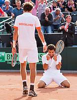 15-09-12, Netherlands, Amsterdam, Tennis, Daviscup Netherlands-Suisse, Doubles, Robin Haase/Jean-Julian Rojer , defeat   Roger Federer/Stanislas Wawrinka.