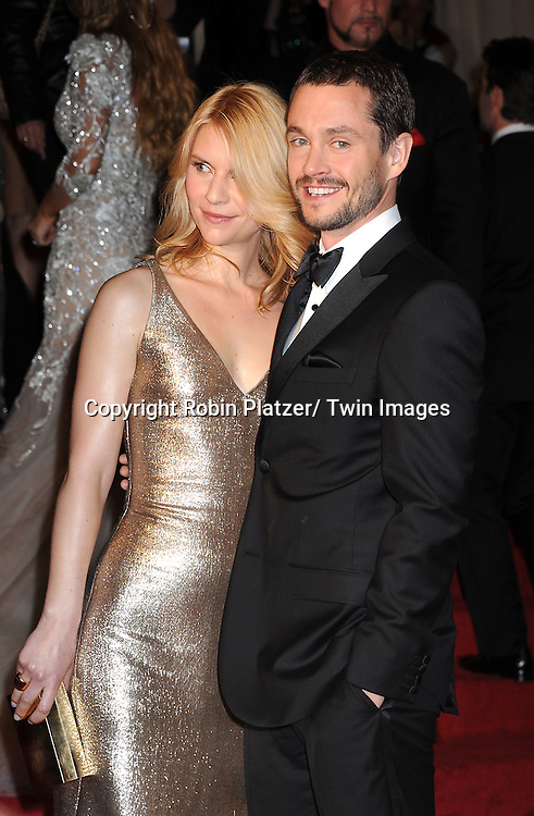 """Claire Danes and husband Hugh Dancy arriving at The Costume Institute Gala Benefit celebriting """"Alexander McQueen: Savage Beauty"""" at The Metropolitan Museum of Art in New York City on May 2, 2011."""