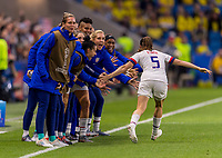 LE HAVRE,  - JUNE 20: Kelley O'Hara #5 celebrates a goal with the bench during a game between Sweden and USWNT at Stade Oceane on June 20, 2019 in Le Havre, France.