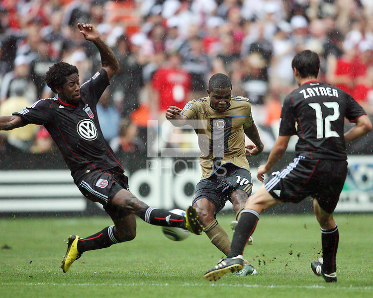 Clyde Simms #19 and Jed Jayner #12 of D.C. United close down Danny Mwanga #10 of the Philadelphia Union during an MLS match at RFK Stadium on August 22 2010, in Washington DC. United won 2-0.