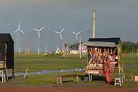 INDIA Westbengal, Sundarbans, Sagar Island, shop for devotionals infront of wind park / INDIEN Westbengalen, Sagar Insel im Gangesdelta Sunderbans, Devotionalien Laden vor Windpark
