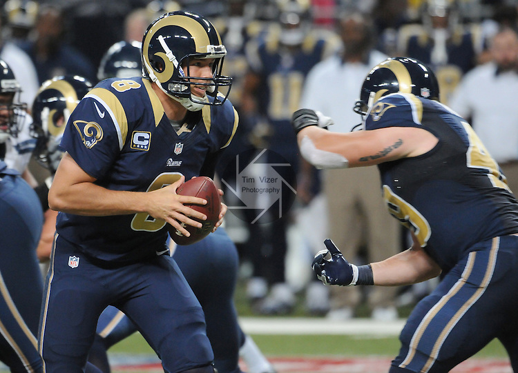 Football - NFL- Seattle Seahawks at St. Louis Rams.St. Louis Rams quarterback Sam Bradford (8) fakes a handoff to St. Louis Rams fullback Brit Miller (49) in the second quarter at the Edward Jones Dome in their game against the Seattle Seahawks. The Rams defeated the Seahawks, 19-13.