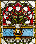 Memorial stained glass window of vase and lily flowers, in village parish church, Saint John the Baptist, Butley, Suffolk, England, UK