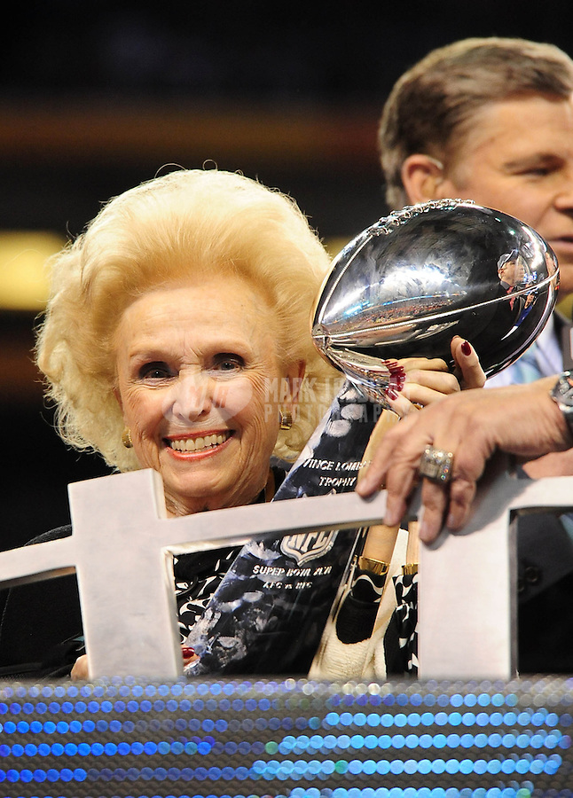 Feb 5, 2012; Indianapolis, IN, USA; Mother of the New York Giants president and CEO John Mara (not pictured), Ann Mara, holds the Vince Lombardi Trophy after Super Bowl XLVI against the New England Patriots at Lucas Oil Stadium. Giants won 21-17. Mandatory Credit: Mark J. Rebilas-..